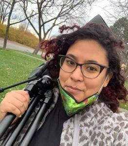 Yamina with binoculars